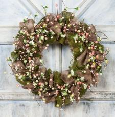 BURLAP WREATH WITH MIXED BERRIES AND PARCHMENT FLOWERS  ON A