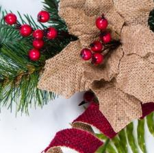 BURLAP POINSETTIA AND RIBBON SPRAY WITH RED BERRIES AND GREE