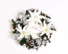 CREAM VELVET POINTSETIA WREATH ON A TWIG BASE WITH GREEN AND