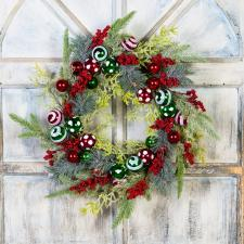 CHRISTMAS WREATH WITH ORNAMENTS AND BERRIES ON A TWIG BASE,
